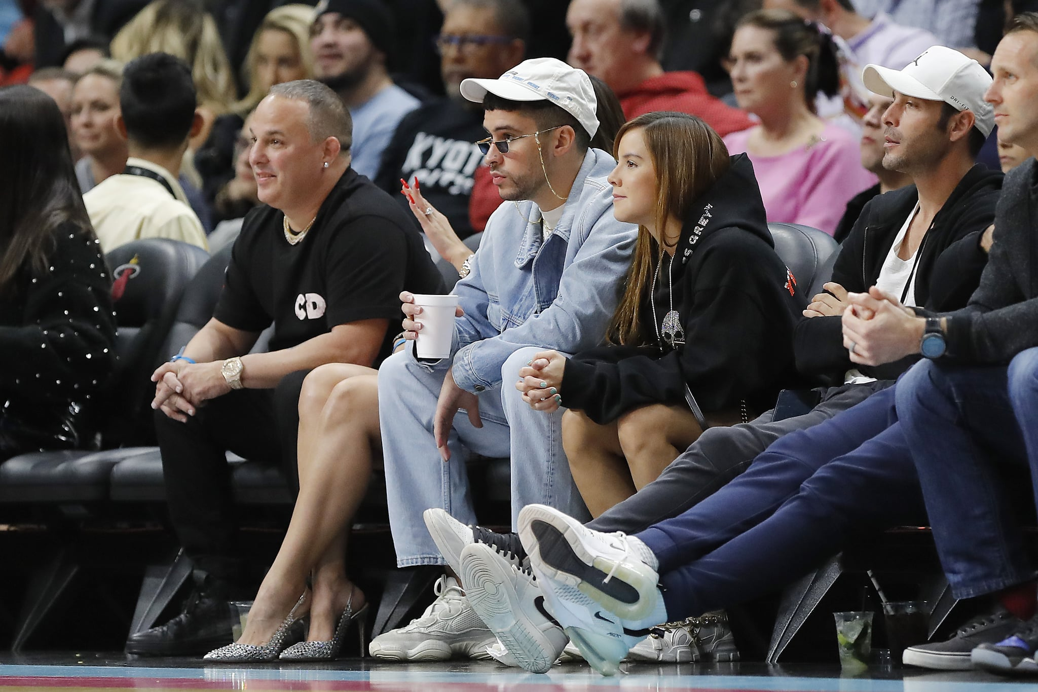 MIAMI, FLORIDA - FEBRUARY 28:  Music artist Bad Bunny looks on during the first half between the Miami Heat and the Dallas Mavericks at American Airlines Arena on February 28, 2020 in Miami, Florida. NOTE TO USER: User expressly acknowledges and agrees that, by downloading and/or using this photograph, user is consenting to the terms and conditions of the Getty Images License Agreement.  (Photo by Michael Reaves/Getty Images)