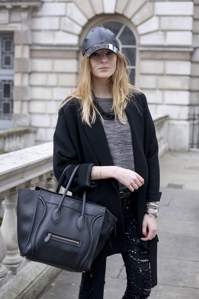 Blogger Camille Charrière sported a H&M cap at London Fashion Week.