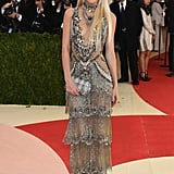 7.To complete the look, Charlotte created the illusion of elongated, gilded-looking limbs with her Supermodel Body ($88), a slimmer shimmer that acts as shapewear lingerie for the body and catches the light for a glowing finish.