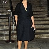 Carolina Herrera punched up her sleek black knee-length cocktail dress with bright pink satin kitten heels.