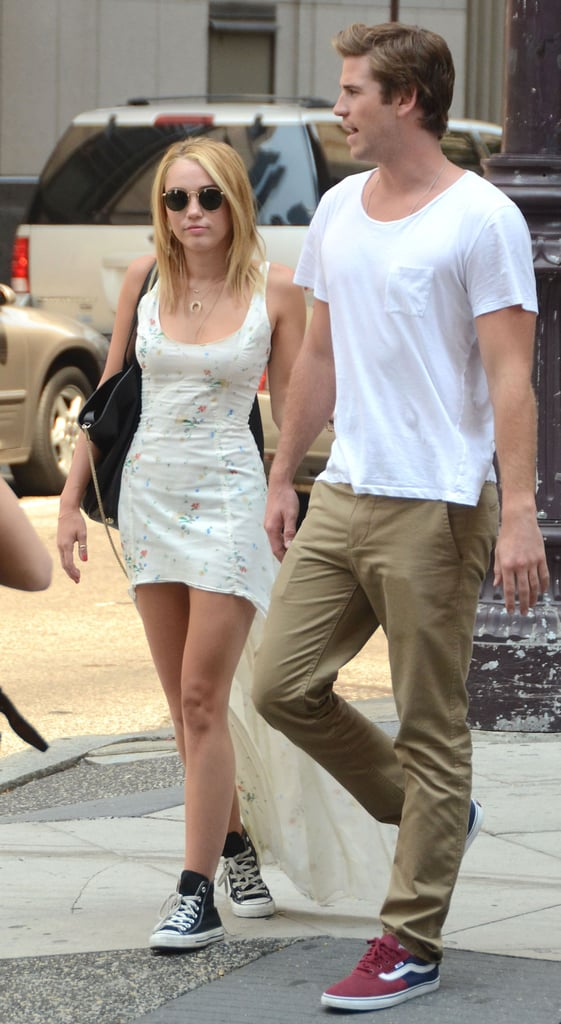 """Miley Cyrus and Liam Hemsworth held hands as they left The Capital Grille in Philadelphia yesterday. The couple, who announced their engagement last month, headed to Pennsylvania together from LA on Tuesday.  Liam is in the city to start work on the new thriller Paranoia, which costars Harrison Ford and Amber Heard. It's the second big-screen project he's worked on so far this Summer after shooting Empire State in New Orleans and NYC. Miley visited Liam on the Louisiana set of that film and has spent lots of time close to home in LA lately as well, taking Pilates classes and walking her dog. Earlier this month, she also debuted some new ink. Miley's new tattoo features a quote from President Roosevelt, and, in keeping with her engagement and the more grown-up image she's presented lately, she's promised that her new album will reflect the more """"adult"""" phase of her life."""