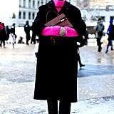 Natalie Joos added a jolt of high-wattage hot pink to black outerwear.