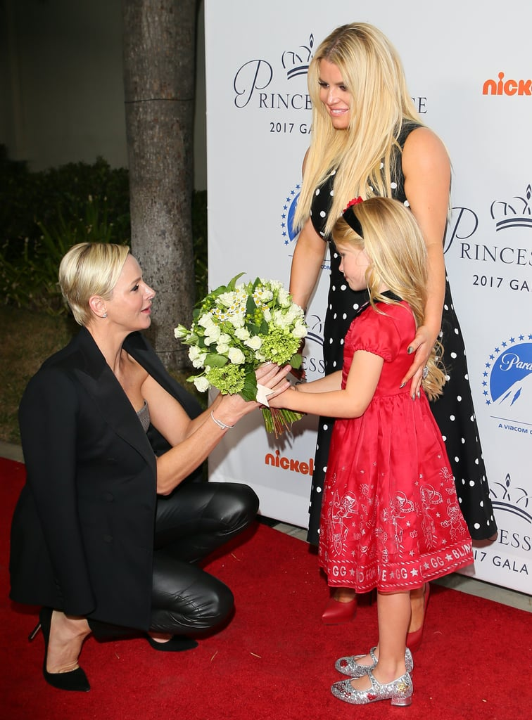 Jessica Simpson and her daughter Maxwell rubbed shoulders with royalty when they hit the red carpet in LA on Tuesday. During the Princess Grace Awards Gala Kick Off Event at Paramount Pictures, the mother-daughter duo met up with Princess Charlene of Monaco, whose husband, Prince Albert II, is the son of the late Grace Kelly and Prince Rainier III. Not only did the blonde bombshells pose for a few photos together, but the 5-year-old even shared a sweet moment with the princess as she offered her flowers. Charlene then returned the favor by giving Maxwell a warm hug. Aww! See their adorable interaction below.      Related:                                                                                                           16 Times Jessica Simpson Showed That Her Body Was Built For Flaunting