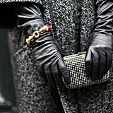 A studded minaudière looked right at home between leather gloves.