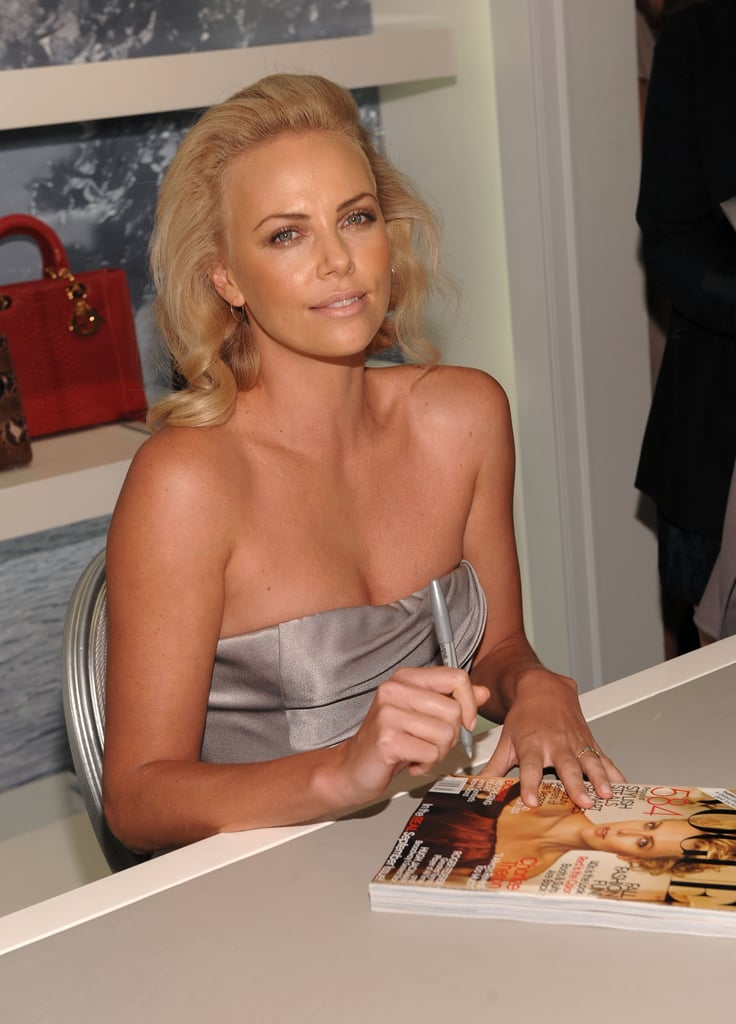 Charlize Theron signed autographs at the Dior party in 2009.