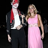 Actress and singer Aly Michalka went with a pink dress, while her date went all out with blood.