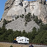 Tourists stopped along the highway to snap pictures of Mount Rushmore, since it was closed along with all the other national parks.