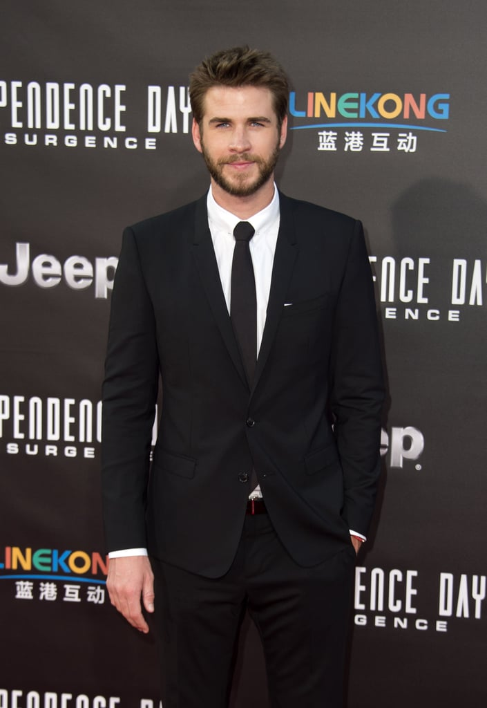 "All eyes were on Liam Hemsworth when he arrived at the LA premiere of his latest film, Independence Day: Resurgence, on Monday evening. The actor, who recently returned from NYC, could not have looked any more perfect in a sexy suit and tie. This is just the latest we've seen since he kicked off the promo tour for the movie in his native Australia earlier this month. In addition, Liam has also been grabbing headlines for his rekindled romance with Miley Cyrus. Over the weekend, the ""Wrecking Ball"" singer took to Instagram to share a mirror selfie of herself wearing a tee with Liam's last name written across the back. See more of Liam now, then watch him absolutely destroy Jimmy Fallon during a game of Slip and Flip."
