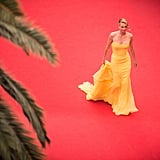 Charlize Theron stunned in a golden gown in 2015, while she was promoting Mad Max: Fury Road.