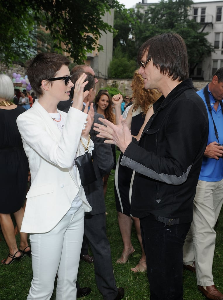Anne Hathaway got animated with Jim Carrey at Stella McCartney's Spring presentation in NYC.