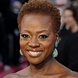Viola Davis lit up the red carpet in a pair of dazzling emerald-green earrings.