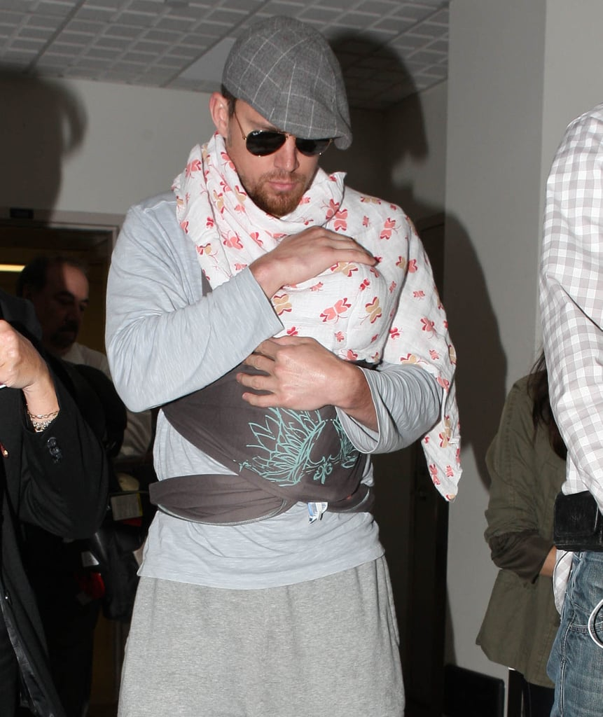 Channing Tatum cradled his daughter, Everly, at LAX.
