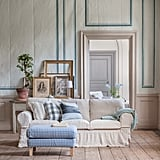 Pictured:  Ektorp three-seater with loose fit country sofa cover in unbleached rosendal pure washed linen fabric Karlstad footstool cover covered in vreta gingham blue and white.    Cushion covered in Stockholm stripe sand beige, cloud brera quadretto (discontinued).