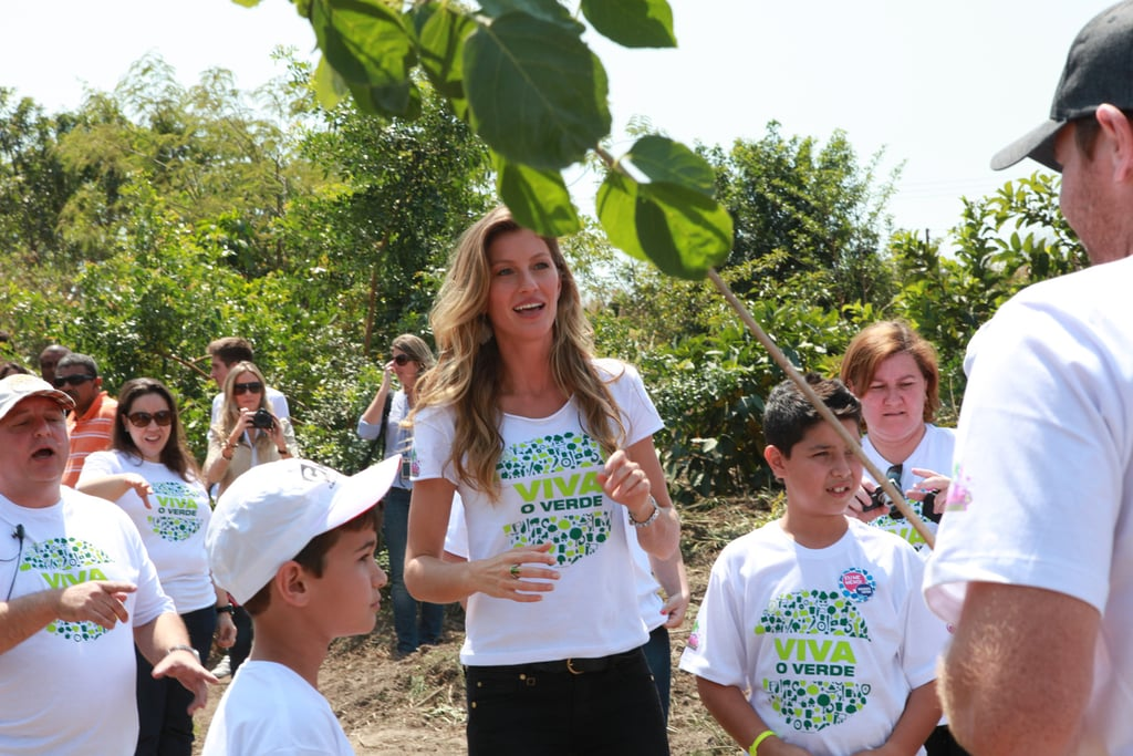 Gisele Bundchen planted seeds with 80 kids in Sao Paolo.