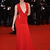 Kristen Stewart wore a red Reem Acra gown at the 2012 Cannes premiere of Cosmopolis.