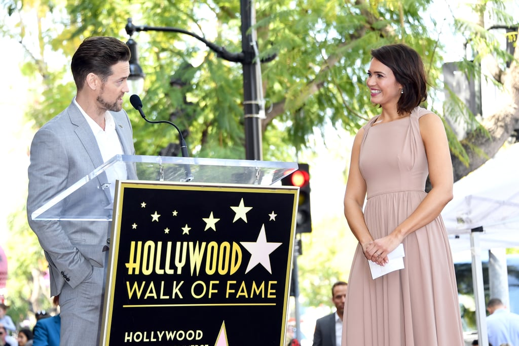 """Mandy Moore and Shane West's bond is still as sweet as when they costarred in A Walk to Remember 17 years ago. The former costars made us fall in love with them all over again when they reunited at Moore's Walk of Fame ceremony on Monday. During his speech, West took a moment to reflect on what it was like working with Moore on the 2002 Nicholas Sparks film. """"Not only was this film a wonderful experience in every way, it also gave me the chance to fall for this fantastic woman,"""" he said. """"Your energy is irresistible and your heart is second to none. I always knew you were incredibly talented and I always knew you were going to go on to do big things and amazing things, and you have . . . I couldn't be more proud of you."""" As if that speech wasn't enough to make us turn into mush, the two later took the nostalgia up a notch by recreating their iconic pose from the movie poster. """"Stars have always sort of been our thing,"""" Moore wrote. """"Thankful to @theshanewest for his kind words on this very special day, one which I will never forget. It was a walk (of fame) to remember.🌟"""" Now if you don't mind, I'm just going to rewatch the movie and sob.       Related:                                                                                                           Mandy Moore's 20-Year Evolution Is So Sweet, It's Just Like Candy"""