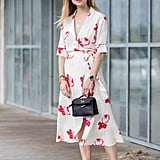Consider mixing one throw-on-and-go with another by styling your floral wrap dress with a pair of casual skimmers.