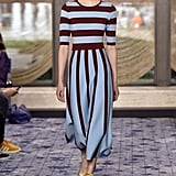 This oxblood and pastel blue striped dress would fit smartly into Melania's Spring and Summer wardrobe, finished with flats for a more casual day trip on Air Force One.
