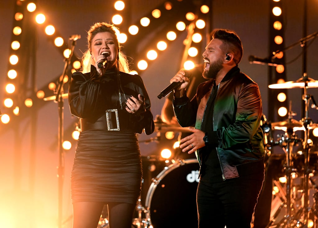 """Kelly Clarkson brought the house down with mother-in-law Reba McIntire at the ACM Awards last year, and her appearance at this year's event was just as powerful. On Sunday night the """"Piece by Piece"""" singer joined Dan + Shay for an emotional rendition of the country duo's hit """"Keepin' Score."""" Dressed in a glamorous high-necked gown that she appropriately accessorised with a belt the size of Nashville, Clarkson floored the audience with her pitch-perfect vocals (what else is new?!). Along with Dan Smyers and Shay Mooney, Clarkson belted out moving lyrics like """"You know I'm only human, don't know how many sunsets I've got left,"""" as the crowd got to their feet.  Watch the trio do their thing ahead, and then peep a few extra moments from their performance as you keep scrolling!      Related:                                                                                                                                Kelly Clarkson's """"Piece by Piece"""" Performance Got Extra Emotional When Her Husband Surprised Her"""