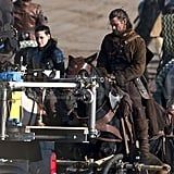 Kristen Stewart as Snow White and Chris Hemsworth as the huntsman on the set of Snow White and the Huntsman.