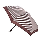 There's no greater pain than leaving your house on a rainy day, only to find that you've dashed out without an umbrella. To avoid the dreaded scenario, I've been keeping this umbrella by Henri Bendel ($58) in my purse at all times. It comes in a preppy brown and white striped pattern making it an effective, yet stylish method of shelter. It's also tiny and lightweight so it won't weigh down your purse. If you're looking for the perfect umbrella to double as a rainy-weather accessory, this has you covered. — Aimee Simeon, editorial assistant, Social	  This Henri Bendel umbrella was hand-selected to be featured in the POPSUGAR Must Have box and is one of our favorite accessories right now. Subscribe to the Must Have box to receive treats like this monthly!""