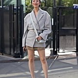 Style Beige Shorts With a Belted Blazer and Brown Heels