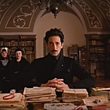Dmitri (Adrien Brody) puts on a serious face.