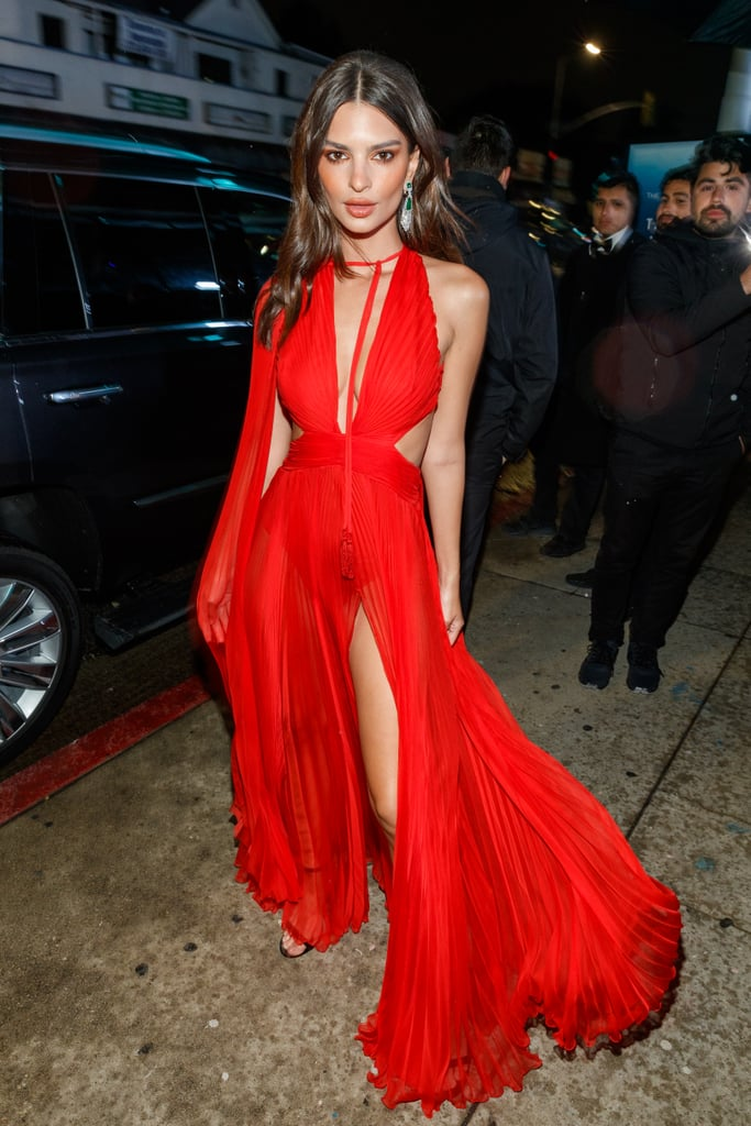 "The cutouts! The slit! The sheer skirt! Emily Ratajkowski stepped out at The Art of Elysium Heaven Gala on Jan. 5 in what might go down as one of her sexiest looks yet. Never mind the event's ""heavenly"" theme, the 27-year-old model and entrepreneur went for a devilishly red pleated Peter Dundas gown with a plunging neckline and an exposed back for the occasion.  The daring dress features a see-through skirt and shoulder cape, overlaying an opaque bodysuit. Is it just me, or does this hearken back to one of her classic one-pieces? Leave it to Emily, the brain behind Inamorata swimwear, to give a little nod toward those warmer days ahead. She paired the fiery gown with green statement earrings and strappy black heels.  Keep reading to see Emily's dramatic look from all angles. It's so good, it's almost sinful.       Related:                                                                                                           The 25 Hands-Down Sexiest Shoes in Emily Ratajkowski's Killer Wardrobe"