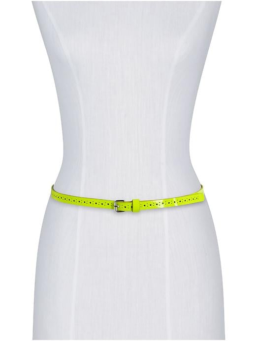 Wear this skinny neon belt over your LWD for a fresh pop of color.  Hive & Honey Perforated Neon Belt ($28)