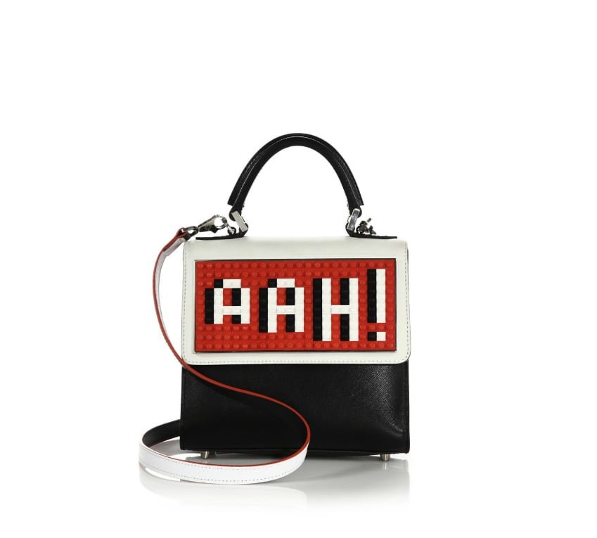 """Between the clothes, the stars, and the crowds, this Les Petits Joueurs """"Ahh"""" satchel ($970) sums up Fashion Week thoughts and will, no doubt, go well with a variety of different ensembles.  — SS"""
