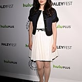 She added a cropped jacket and skinny belt to her crisp white dress for a quick jolt of color contrast at the 2012 PaleyFest New Girl panel.