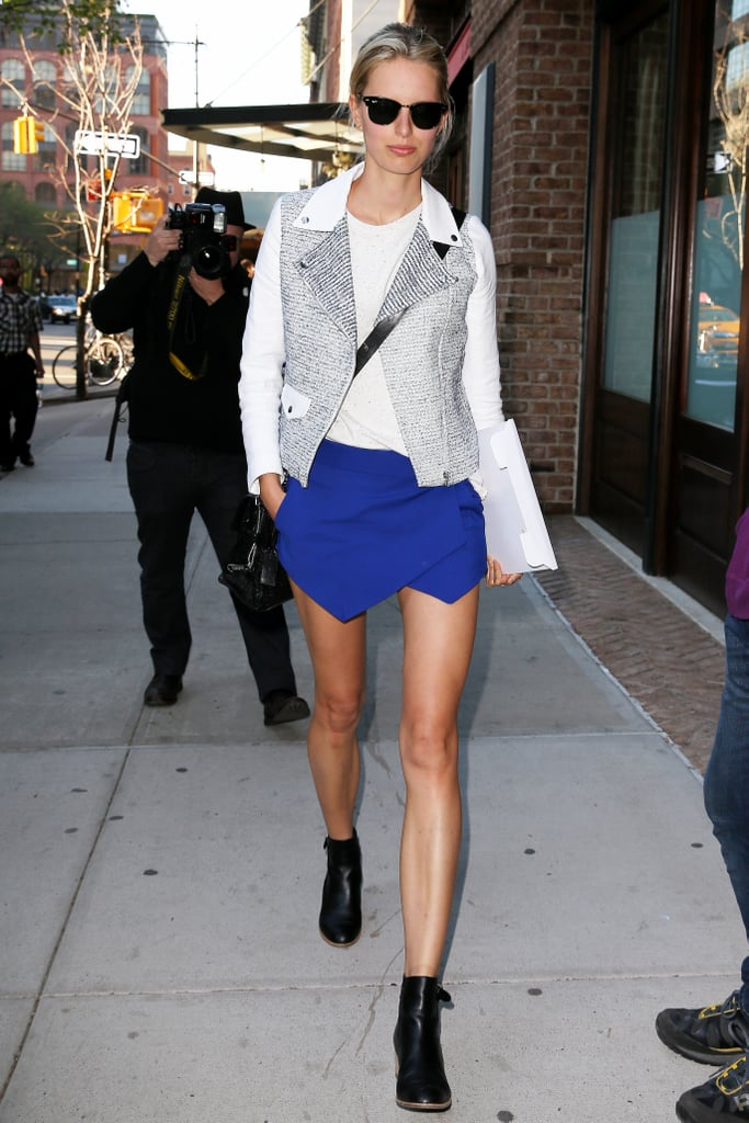 Karolina Kurkova experiments with silhouettes in this architectural skirt and moto jacket.