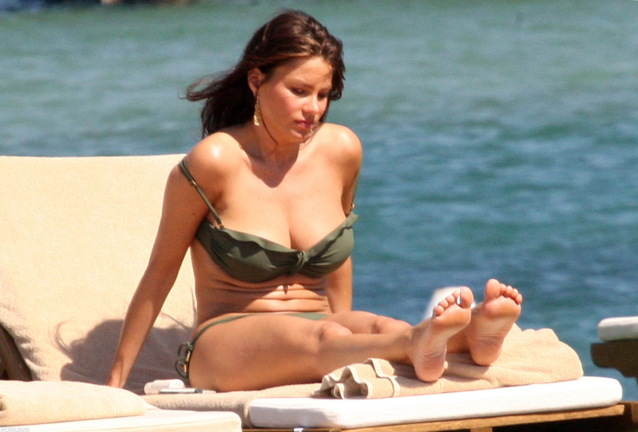 Sofia worked on her tan in Porto Cervo in July 2010.
