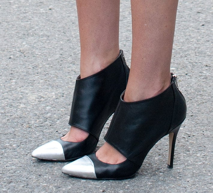 Pointed-toe pumps with a metallic cap-toe would make a welcome addition to any girl's street-chic wardrobe.