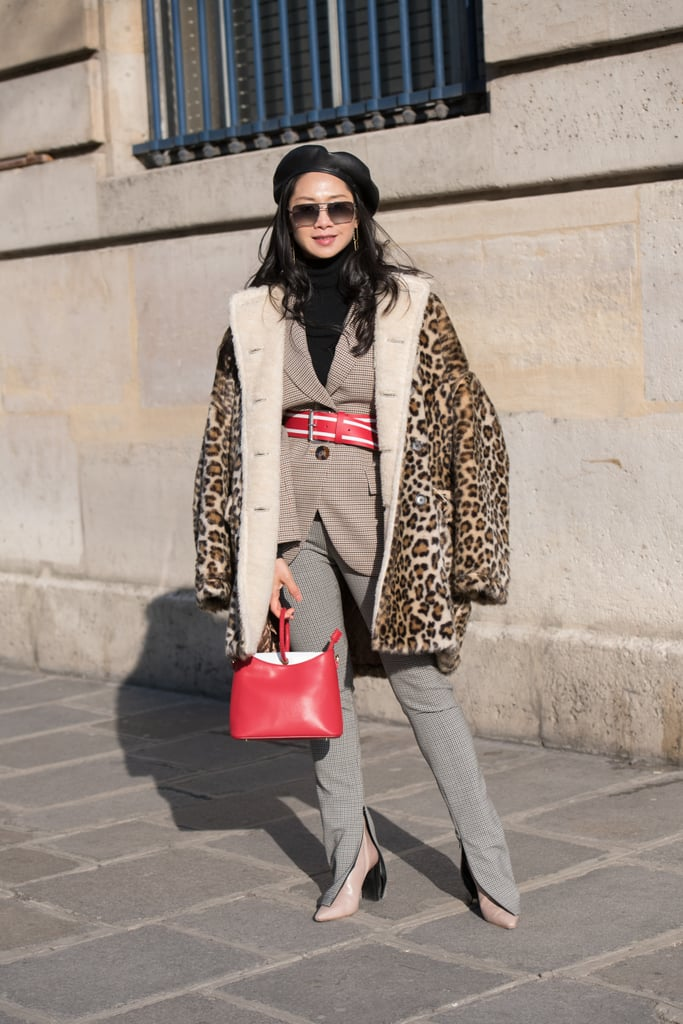 A Leopard Print Coat Over a Belted Blazer, Grey Trousers, and Boots