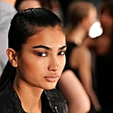 Instead of an over-the-top routine, use your bronzer for contouring and eye shadow, like this look from Nanette Lepore.