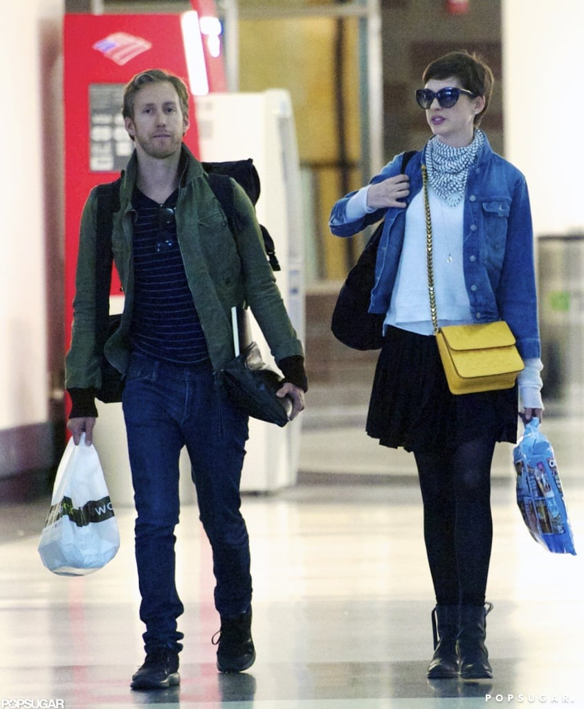 Newlyweds Anne Hathaway and Adam Shulman made their way through LAX together yesterday. The couple are getting out of town after celebrating their wedding over the weekend. Anne and Adam were married at a private estate in Big Sur on Saturday and posed for pictures following the ceremony. Anne wore a custom gown designed by Valentino that she accessorized with a floral headpiece. The recent bride was showing off another new accessory — her wedding band — at the airport yesterday! She debuted the ring earlier in the day during a shopping trip to Wasteland with Adam before catching their flight. He had his new bling on as well, and it looks like the duo are off to relax now that they've wrapped up their wedding duties.