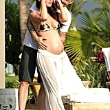 Megan Fox showed off her pregnant stomach in Hawaii with Brian Austin Green.