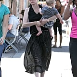 January Jones carried baby Xander while walking in LA.