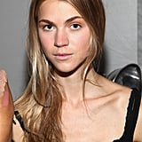 For an easy, just-went-to-the-beach face, models wore Laura Mercier Tinted Moisturizer with Yves Saint Laurent Touche Éclat to highlight. To mute the lips' natural color, concealer was patted on before Sephora Rouge Shine Lipstick in Tenderness was lightly pressed in.