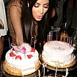 Kim blew out the candles on her birthday cake during a party at LA's Les Deux club in October 2007.