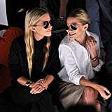 The sister put on their shades when the lights came up on the runway.