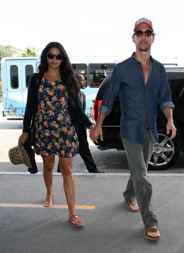 Camila Alves wore a floral dress to travel with Matthew McConaughey.