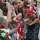 Kate Middleton carried flowers from fans in Canada.