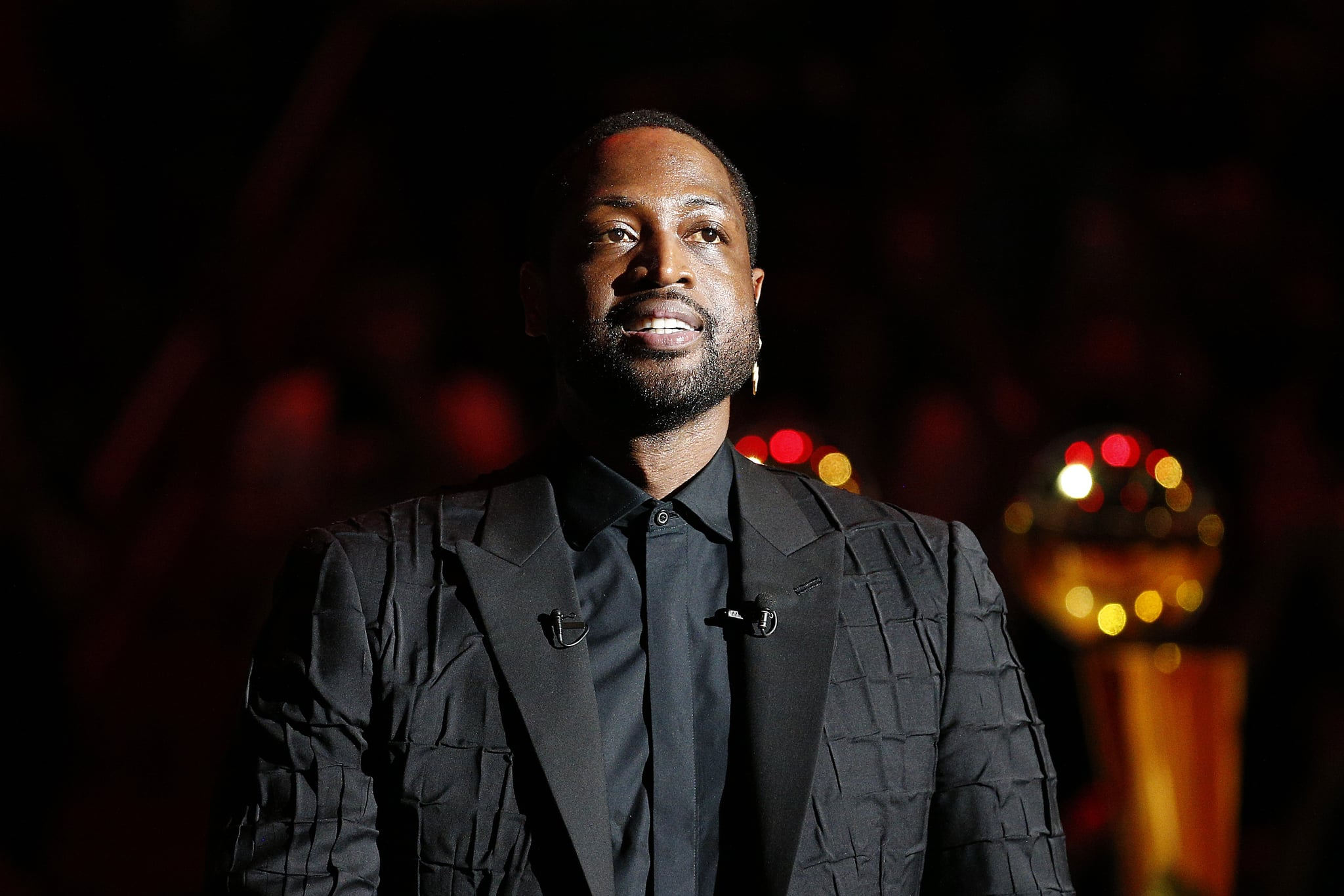 MIAMI, FLORIDA - FEBRUARY 22:  Former Miami Heat player Dwyane Wade addresses the crowd during his jersey retirement ceremony at American Airlines Arena on February 22, 2020 in Miami, Florida. NOTE TO USER: User expressly acknowledges and agrees that, by downloading and/or using this photograph, user is consenting to the terms and conditions of the Getty Images Licence Agreement.  (Photo by Michael Reaves/Getty Images)
