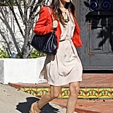 We love that Rachel Bilson's red Vanessa Bruno blazer adds a playful pop of color to her neutral sundress and booties.