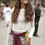 Joan Smalls channeled her inner '90s girl with a little plaid wrapped around her waist.
