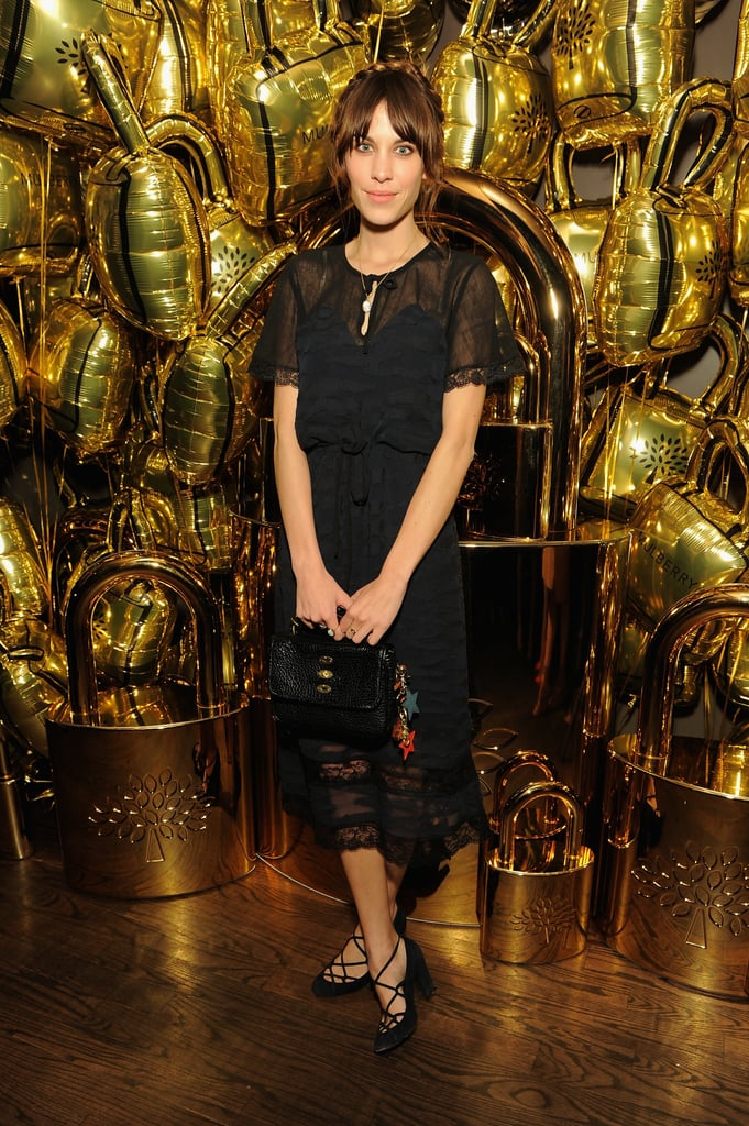 Alexa Chung teamed a Mulberry gathered lace dress with a black Bryn bag for the Mulberry and Frieze Project Artists dinner in New York City.
