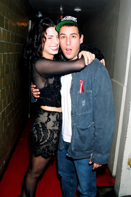 Adam Sandler kept Sandra cracking up backstage at the MTV's September 1994 Video Music Awards held in NYC.