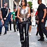 Kim first debuted these while leaving the Balenciaga store in Soho on Sept. 10. This time, she styled her slacks with a shimmery chainmail tank.